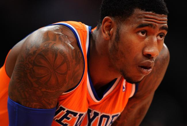 hi-res-187595820-iman-shumpert-of-the-new-york-knicks-looks-on-during_crop_north